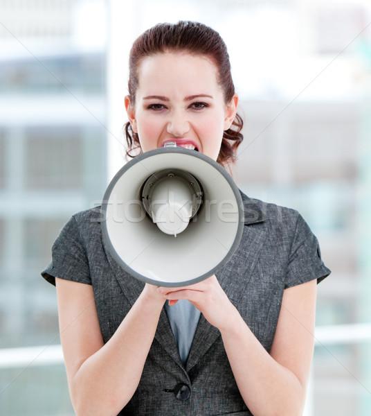Furious businesswoman yelling through a megaphone  Stock photo © wavebreak_media