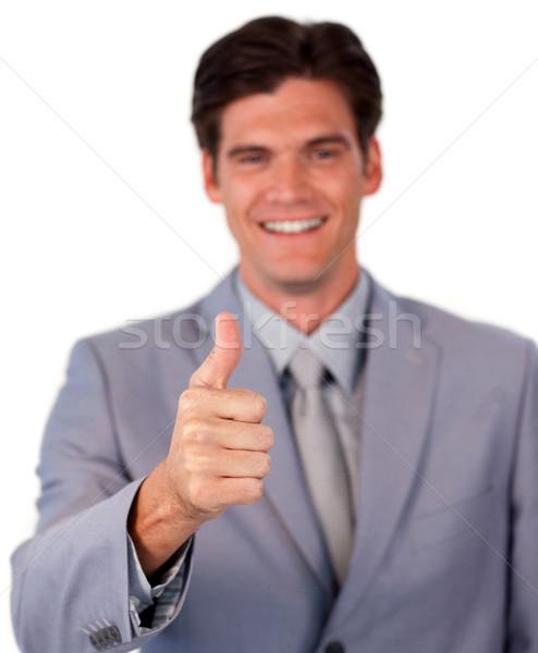 Sonriendo empresario pulgar hasta blanco negocios Foto stock © wavebreak_media