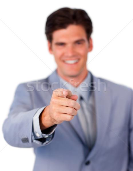 Positive businessman pointing at the camera  Stock photo © wavebreak_media