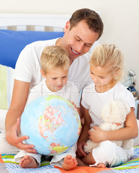 Adorable children and their father looking at a terrestrial glob Stock photo © wavebreak_media