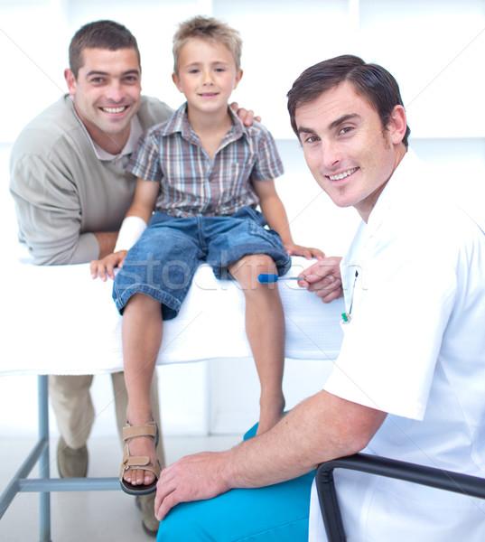 Doctor checking a boy reflexes Stock photo © wavebreak_media