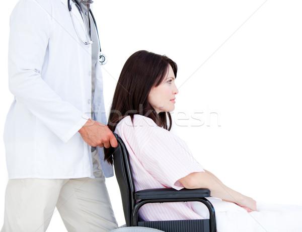 Alterar femenino paciente silla de ruedas médico blanco Foto stock © wavebreak_media