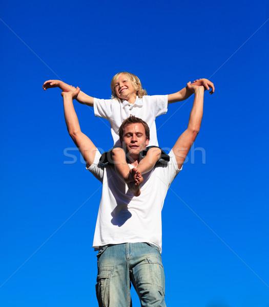 Dad giving his son a piggyback ride Stock photo © wavebreak_media