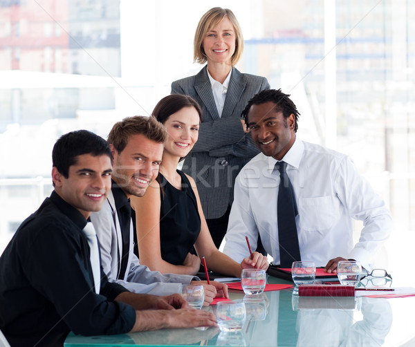 Business team smiling at the camera in office Stock photo © wavebreak_media