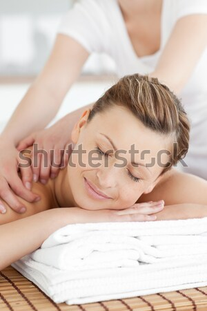 Relaxed woman receiving a back massage Stock photo © wavebreak_media