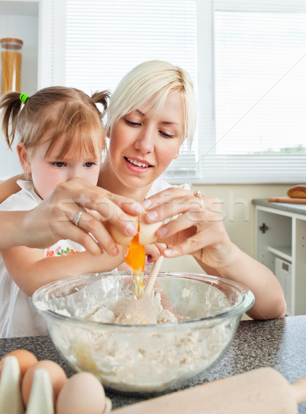 Relaxed mother and child baking cookies in kitchen Stock photo © wavebreak_media