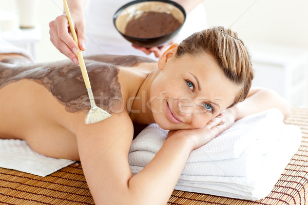 Pretty young woman enjoying a beauty treatment with mud in a health spa Stock photo © wavebreak_media
