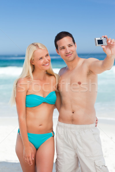 Couple taking a photo of themselves on the beach Stock photo © wavebreak_media
