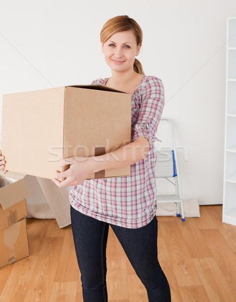 Cute woman carrying cardboard boxes Stock photo © wavebreak_media