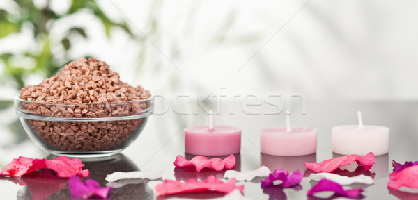 A bowl of brown gravel with pink petals and candles Stock photo © wavebreak_media