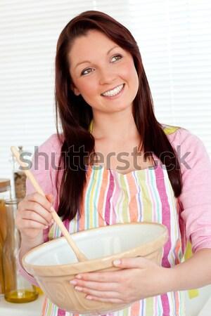 Cute dark-haired woman having a tea in her kitchen Stock photo © wavebreak_media