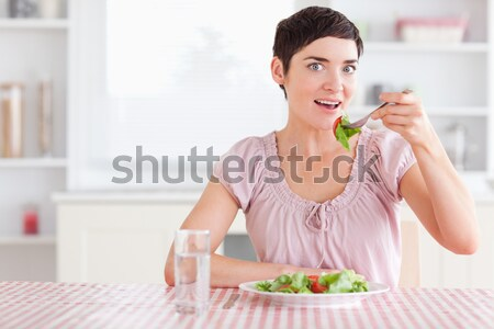 Woman toasting with wine in a kitchen Stock photo © wavebreak_media