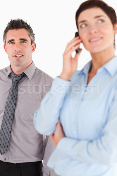 Portrait of a woman on the phone call while her coworker is posing against a white background Stock photo © wavebreak_media