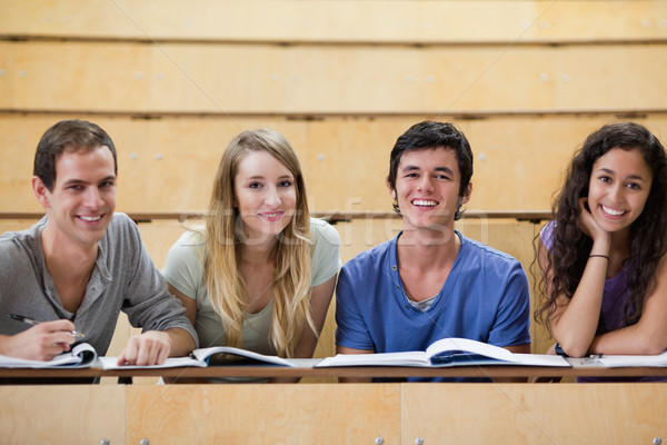 Smiling students working together in an amphitheater Stock photo © wavebreak_media