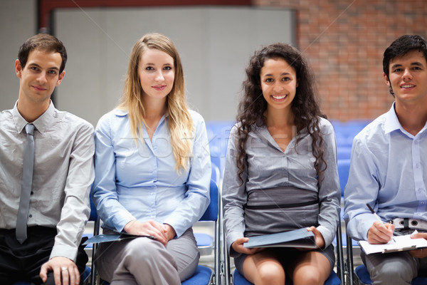 Business people sitting on chairs during a presentation Stock photo © wavebreak_media