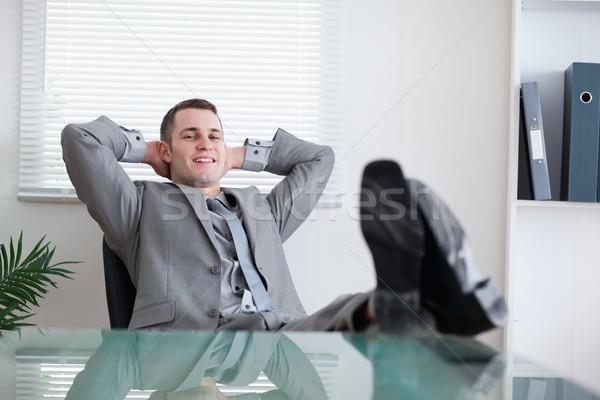 Happy smiling businessman taking a rest Stock photo © wavebreak_media