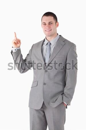 Zdjęcia stock: Portret · uśmiechnięty · młodych · biznesmen · wskazując · coś