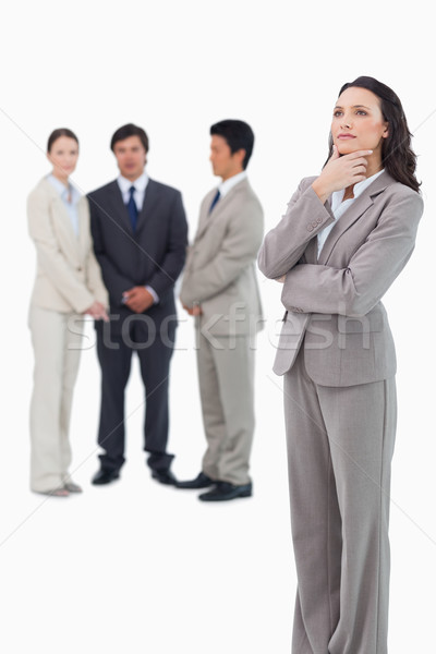 Thoughtful saleswoman with team behind her against a white background Stock photo © wavebreak_media