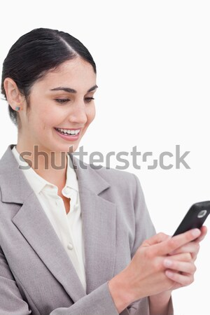 Close up of smiling businesswoman reading text message against a white background Stock photo © wavebreak_media