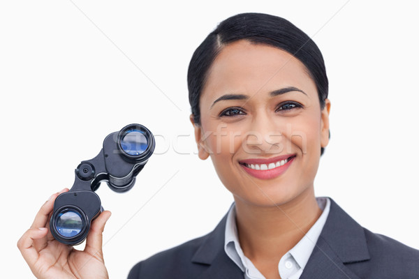 Close up of smiling saleswoman with spy glasses against a white background Stock photo © wavebreak_media