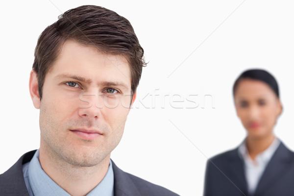 Jonge verkoper collega achter witte Stockfoto © wavebreak_media