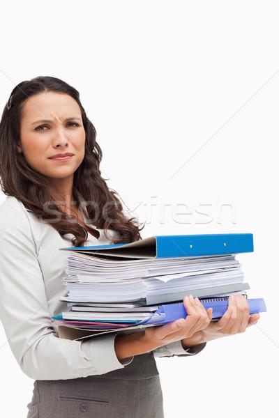 Brunette carrying a lot of files against white background Stock photo © wavebreak_media