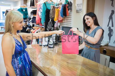 Woman is paying at the counter of the shop Stock photo © wavebreak_media