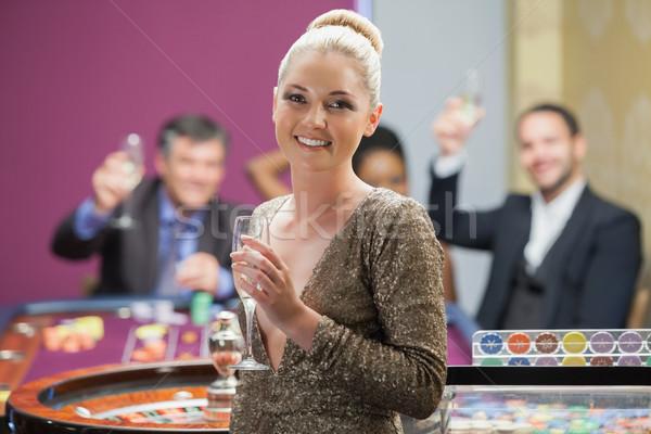 Nő tart pezsgő üveg emberek éljenez Stock fotó © wavebreak_media