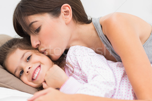 Mother kissing happy daughter on the cheek Stock photo © wavebreak_media