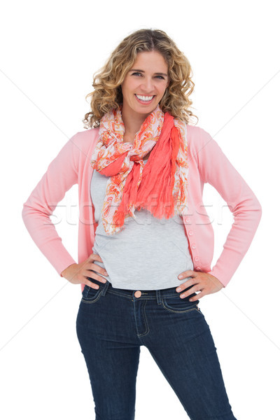 Séduisant femme blonde posant mains hanches blanche Photo stock © wavebreak_media
