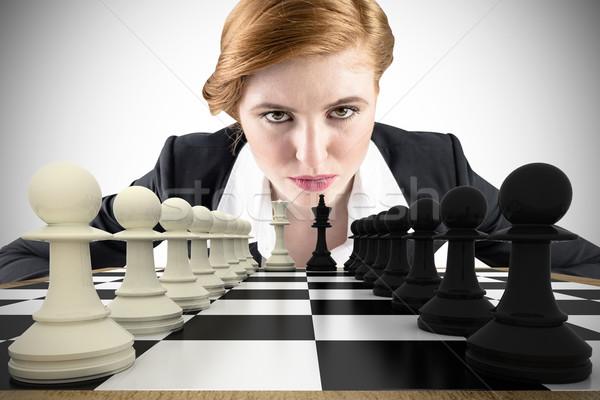Composite image of focused businesswoman Stock photo © wavebreak_media