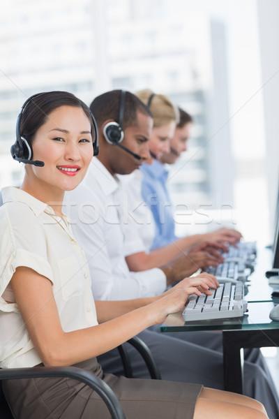 Stock fotó: üzlet · kollégák · számítógépek · asztal · oldalnézet · portré