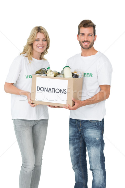 Smiling young couple carrying donation box Stock photo © wavebreak_media