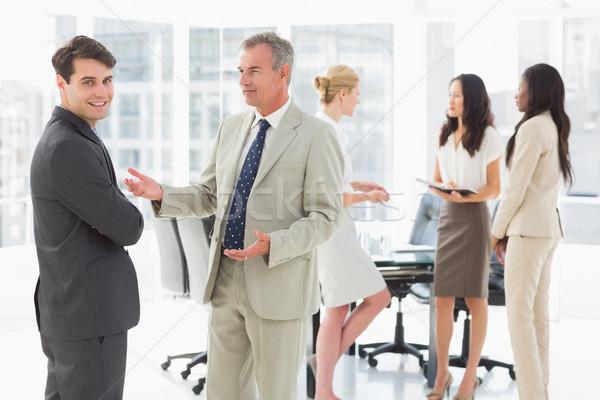 Uomini d'affari parlando insieme sala conferenze ufficio business Foto d'archivio © wavebreak_media