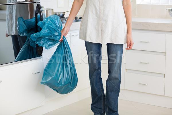 Düşük bölüm kadın çöp çanta Stok fotoğraf © wavebreak_media