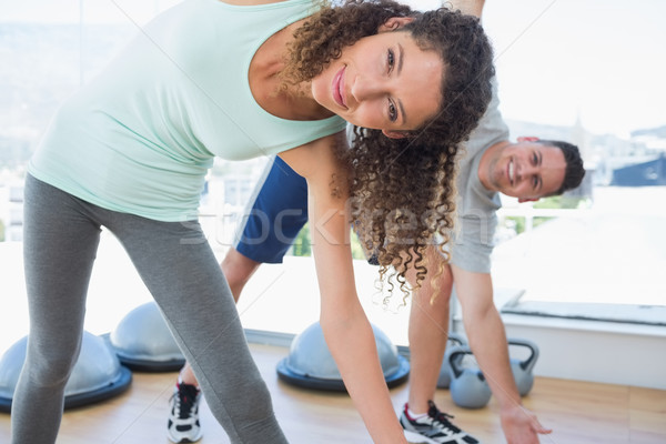 Woman with man doing stretching exercise Stock photo © wavebreak_media