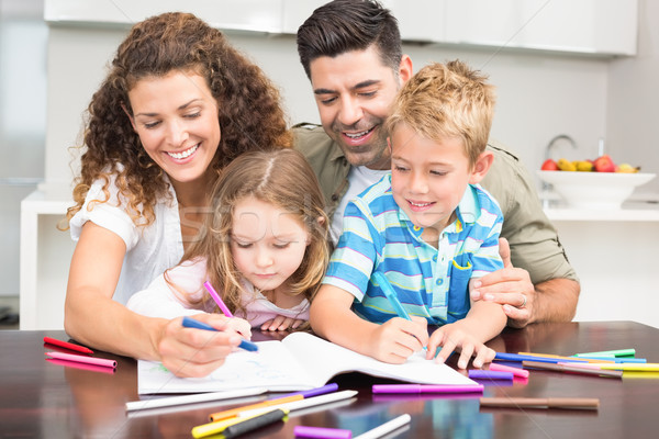 Happy parents colouring with their children at the table Stock photo © wavebreak_media