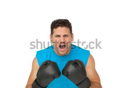Close-up portrait of a determined male boxer screaming Stock photo © wavebreak_media