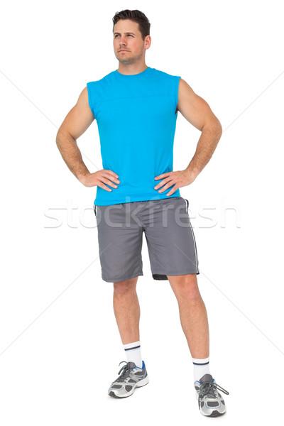 Tam uzunlukta uygun ciddi genç ayakta beyaz Stok fotoğraf © wavebreak_media