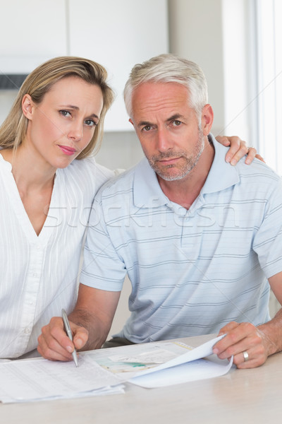 Worried couple working out their finances Stock photo © wavebreak_media