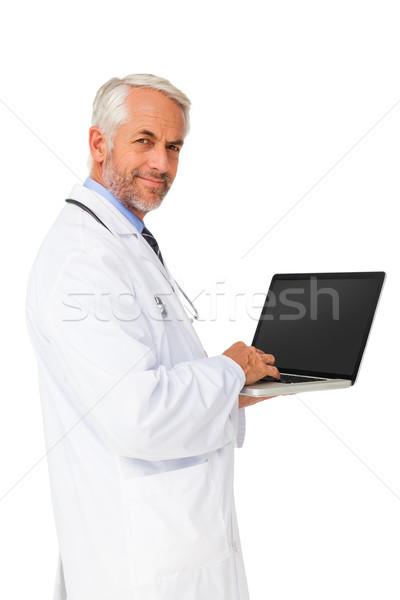 Stock fotó: Portré · tartalom · férfi · orvos · laptopot · használ · fehér · számítógép