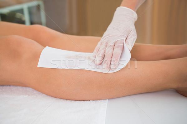Woman getting her legs waxed by beauty therapist Stock photo © wavebreak_media