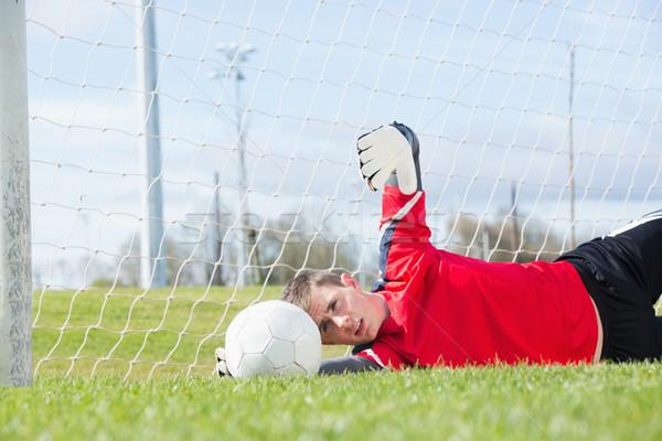 вратарь красный сохранить трава футбола Сток-фото © wavebreak_media