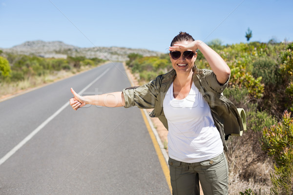 Pretty hitchhiker sticking thumb out on the road Stock photo © wavebreak_media