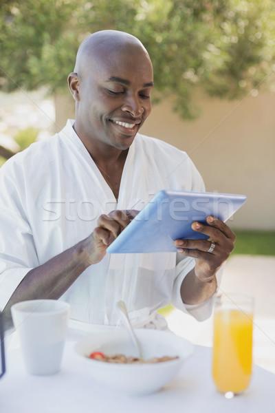 красивый мужчина халат таблетка завтрак за пределами Сток-фото © wavebreak_media