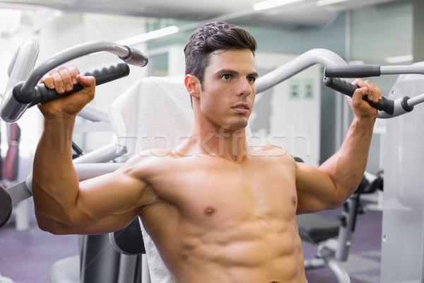 Stockfoto: Gespierd · man · werken · fitness · machine · gymnasium