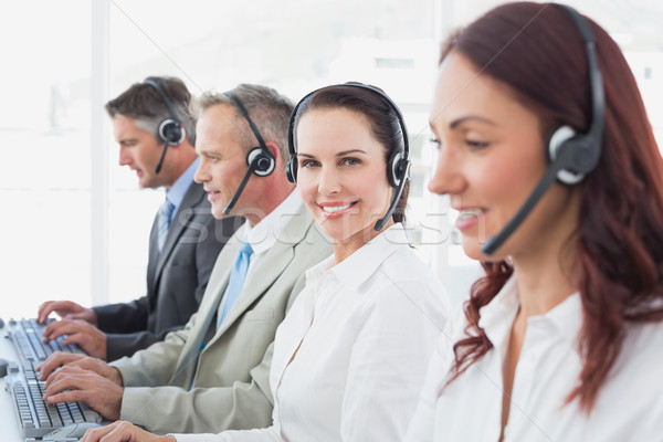 Call center workers all smiling Stock photo © wavebreak_media