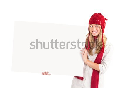 Festive blonde holding large poster  Stock photo © wavebreak_media