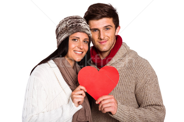 Young couple smiling holding red heart Stock photo © wavebreak_media