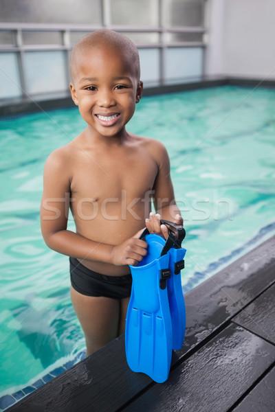 Little boy holding flippers by the pool Stock photo © wavebreak_media